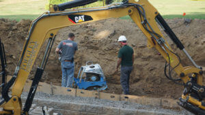 compacting soil behind retaining wall