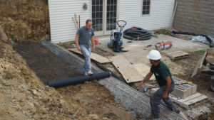 rolling out geo grid retaining wall